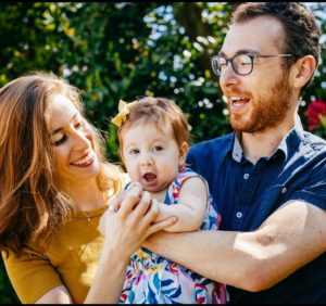 Moishe House Alumni Ally Berman and Michael Godin holding their daughter